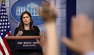 White House press secretary Sarah Huckabee Sanders calls on reporters during the daily briefing in the Briefing Room of the White House in Washington, Thursday, June 14, 2018. (AP Photo/Jacquelyn Martin)
