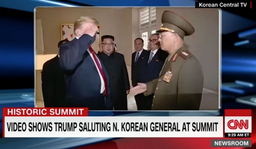 Video footage aired Thursday by North Korean state media showing President Trump returning the salute of a North Korean military general in Singapore has drawn criticism from U.S. media. (CNN)