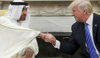 In this May 15, 2017, file photo, U.S. President Donald Trump, right, shakes hands with Abu Dhabi's crown prince, Sheikh Mohammed bin Zayed Al Nahyan, in the White House in Washington. Yemen's yearslong war between Shiite rebels and a Saudi-led coalition backing its exiled government has escalated with an assault on the insurgent-held port city of Hodeida. (AP Photo/Andrew Harnik) **FILE**