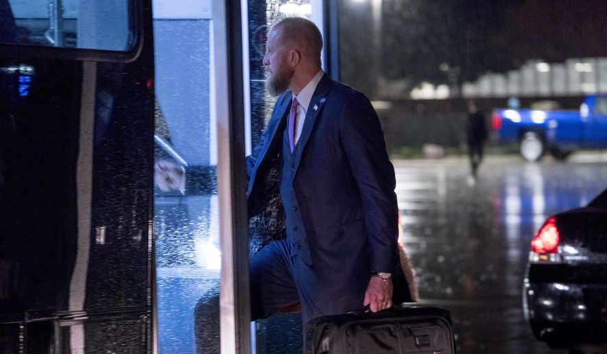 In this May 31, 2018, Brad Parscale, campaign manager for President Donald Trump's 2020 re-election, boards a bus after arriving at Andrews Air Force Base, Md., Thursday, May 31, 2018, to motorcade back to the White House after Trump returns from a visit to Houston and Dallas. (AP Photo/Andrew Harnik, File)