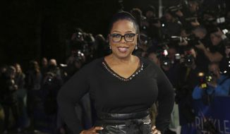 "In this March 13, 2018, file photo, actress Oprah Winfrey poses for photographers upon arrival at the premiere of the film ""A Wrinkle In Time"" in London. (Photo by Joel C Ryan/Invision/AP, File)"
