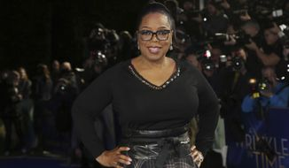 FILE - In this March 13, 2018, file photo, actress Oprah Winfrey poses for photographers upon arrival at the premiere of the film 'A Wrinkle In Time' in London. Apple said Friday, June 15, 2018, it has reached a multi-year deal with Winfrey to create original programs for its streaming service. (Photo by Joel C Ryan/Invision/AP, File)