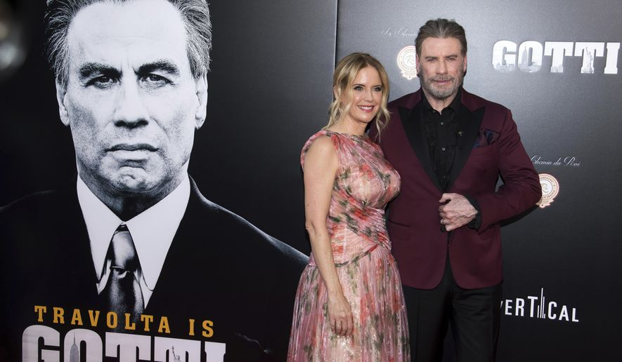 """Kelly Preston and John Travolta attend the premiere of """"Gotti"""" at the SVA Theatre on Thursday, June 14, 2018, in New York. (Photo by Charles Sykes/Invision/AP)"""