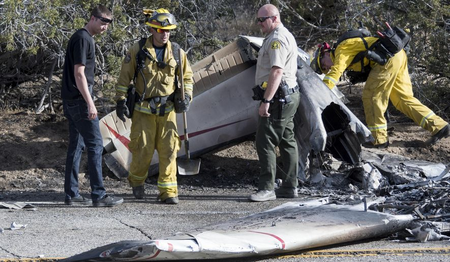 San Bernardino County Sheriff's deputies and San Bernardino County Fire Department firefighters work at the scene of a fatal plane crash near Hesperia Airport on Friday, June 15, 2018, in Hesperia, Calif. (James Quigg/The Daily Press via AP)