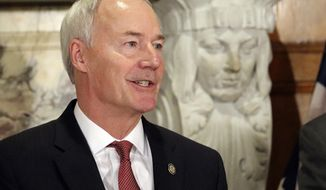 In this March 1, 2018, photo, Arkansas Gov. Asa Hutchinson speaks at a state Capitol news conference in Little Rock. In an appearance before the state Bar Association in Hot Springs, Ark., on Friday, June 15, 2018, Hutchinson said he supported tougher ethics rules for state legislators, which include a nephew, Sen. Jeremy Hutchinson, who has been implicated in a recent federal court case. (AP Photo/Kelly P. Kissel)