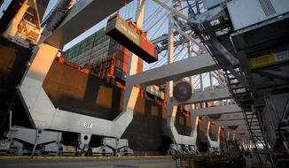 FILE- In this Jan. 30, 2018, file photo, a ship to shore crane loads two shipping containers together onto a vessel at the Georgia Ports Authority's Port of Savannah in Savannah, Ga. China's government renewed its threat Thursday, June 14, to scrap deals with Washington aimed at defusing a sprawling trade dispute as the White House prepared to release a list of Chinese goods targeted for tariff hikes. (AP Photo/Stephen B. Morton, File)