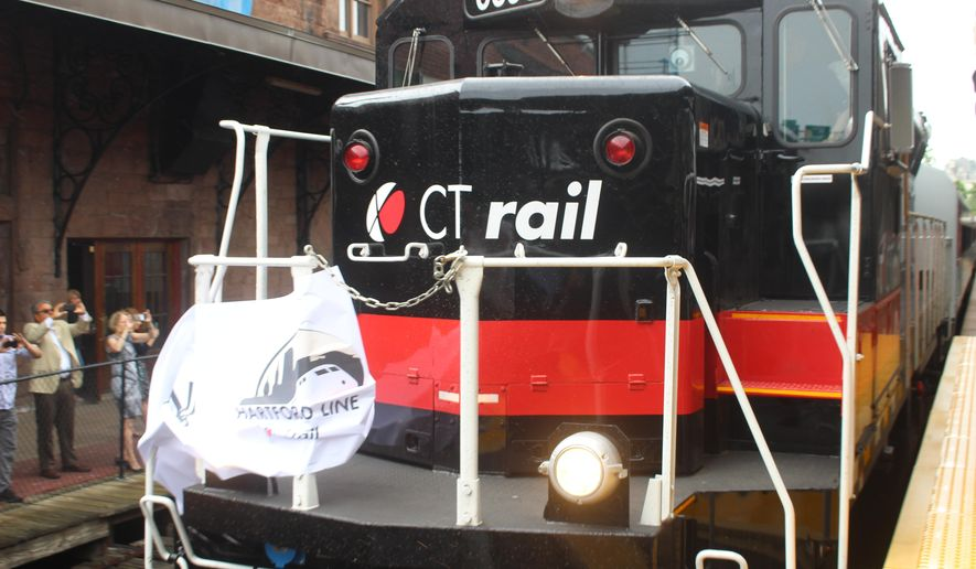 A CTrail train from New Haven, Conn., breaks a ceremonial tape at Hartford's Union Station on Friday June 15, 2018, to mark the opening of the new commuter line linking New Haven, Hartford and Springfield, Mass. (AP Photo/Pat Eaton-Robb)