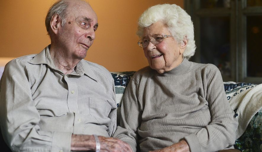 In a June 5, 2018 photo, Ralph and Mary Veon of Chippewa Township bear witness that true love endures. On June 15, they'll celebrate their 78th wedding anniversary. And both will reach another milestone in a few months; turning 100. (Lucy Schaly/Beaver County Times via AP)/Beaver County Times via AP)
