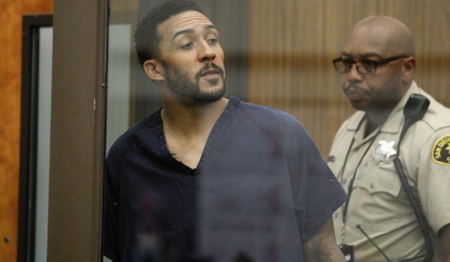 Former NFL football player Kellen Winslow Jr., center, looks through protective glass during his arraignment Friday, June 15, 2018, in Vista, Calif. The former tight end was arrested Thursday on charges of rape and other sex crimes, the day he was to appear in court on an unrelated burglary charge. (Hayne Palmour/San Diego Union-Tribune via AP, Pool) ** FILE **