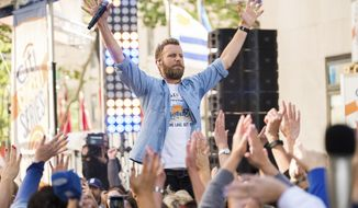 """FILE - In this June 12, 2018 file photo, Dierks Bentley performs on NBC's """"Today"""" show at Rockefeller Plaza in New York. Bentley performed at the CMA Festival last weekend and released a new album, """"The Mountain."""" (Photo by Charles Sykes/Invision/AP, File)"""