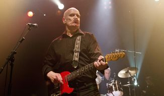 """FILE - In this March 6, 2013, file photo, Wilko Johnson, guitarist and founding member of Dr. Feelgood, performs one of four farewell concerts in the UK, at the Koko club in north London, following his announcement that he has been diagnosed with terminal cancer of the pancreas and has chosen not to undergo chemotherapy. Johnson celebrates life and muses on mortality on his new gritty blues-rock album """"Blow Your Mind,"""" which comes after he was diagnosed with terminal cancer, then unexpectedly reprieved. (Photo by Joel Ryan/Invision/AP, File)"""