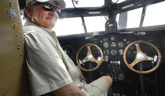 In this Thursday, June 14, 2018 photo, Bill Thacker, an Experimental Aircraft Association pilot, finds the controls in the Ford Tri-Motor aircraft a little bit different from the commercial jets he has flown for United Airlines, in Bloomington, Ill. He is one of a handful of pilots who fly the plane around the country and is flying the plane this weekend at Central Illinois Regional Airport in Bloomington.  The flights are sponsored by the EAA and several local Twin Cities business. The flights are available to the public and scheduled to be flown through Sunday. The plane first flew in 1928. (David Proeber /The Pantagraph via AP)
