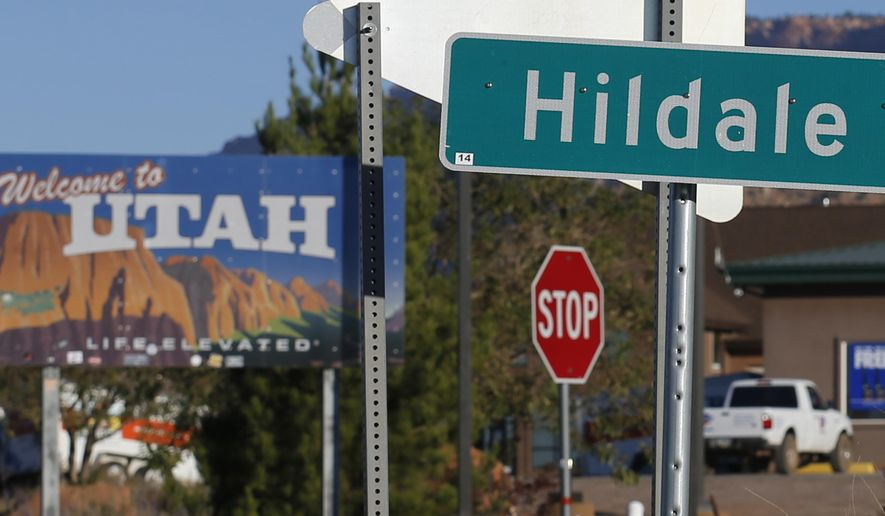 FILE - This Oct. 26, 2017, file photo, shows the area sy the Arizona-Utah state line in Hildale, Utah. Hildale recently dropped its appeal of a court-ordered overhaul of its government operations in a religious discrimination lawsuit. Neighboring Colorado City, Arizona, is still pressing ahead with the appeal. A jury concluded in 2016 that the towns discriminated against people who weren't members of a polygamous sect. The overhaul was a response to the verdict. (AP Photo/Rick Bowmer, File)