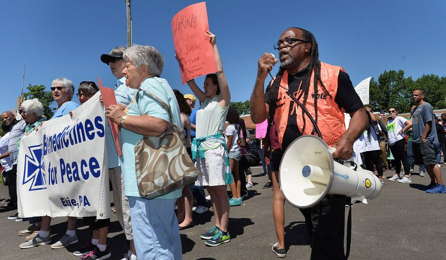 Gary Horton, at right, president of the Erie chapter of the NAACP, organized about 160 people as they prepared to march from the Martin Luther King Center, 312 Chestnut St., to Perry Square in Erie on Thursday, June 14, 2018. They were taking part in the Poor People's Campaign march, on the 50th anniversary of the original campaign, which was inspired by a speech made by the Rev. Martin Luther King a few days before he was killed in April 1968. Several groups organized Thursday's march in Erie, including the Erie Benedictines for Peace, Erie County United and the Erie chapter of the NAACP, among others. (Christopher Millette/Erie Times-News via AP)