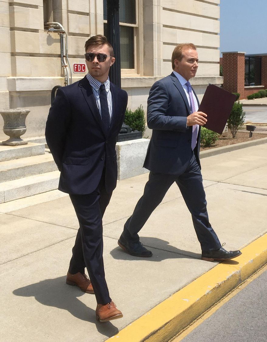 Rene Boucher, right, exits the courthouse, Friday, June 15, 2018, at the William H. Natcher Federal Courthouse in Bowling Green, Ky. Boucher, a neighbor of U.S. Sen. Rand Paul, was sentenced to 30 days in prison on Friday for attacking the senator in a dispute over yard waste. (AP Photo/Dylan Lovan)