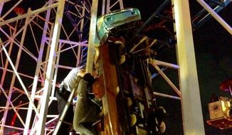 This photo provided by the Daytona Beach Fire department shows emergency crews working on a roller coaster car that derailed at the Daytona Beach Boardwalk on  Thursday, June 14, 2018 in Daytona Beach, Fla.  Two passengers fell 34 feet (10 meters) to the ground and authorities had to pull eight others to safety.  The accident is under investigation according Daytona Beach Fire spokeswoman Sasha Staton.   (Daytona Beach Fire department  via AP)