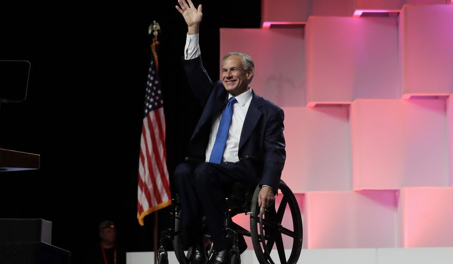Texas Gov. Greg Abbott waves to delegates as the arrives for the Texas GOP Convention, Friday, June 15, 2018, in San Antonio. (AP Photo/Eric Gay)