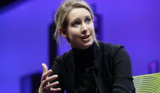 FILE - In this Nov. 2, 2015, file photo, Elizabeth Holmes, founder and CEO of Theranos, speaks at the Fortune Global Forum in San Francisco. Federal prosecutors said Friday, June 15, 2018, they have indicted Holmes on criminal fraud charges for allegedly defrauding investors, doctors and patients as the head of the once-heralded blood-testing startup Theranos. (AP Photo/Jeff Chiu, File)
