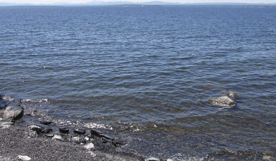 This Friday, June, 15, 2018 photo shows Lake Champlain from the ferry landing in Grand Isle, Vt. Burlington, Vermont, officials said a computer malfunction is to blame for the release of some 3 million gallons of partially-treated wastewater into the lake early on the morning of July 12, 2018. (AP Photo/Lisa Rathke) **FILE**
