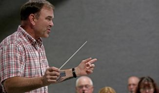 In this June 7, 2018 photo, Fairbanks Community Band conductor Greg Balvanz leads the group during rehearsal in Fairbanks, Alaska. Like many Army veterans residing in Fairbanks, Balvanz got to sample living in different communities across the country before deciding where to retire. (Eric Engman/Fairbanks Daily News-Miner via AP)