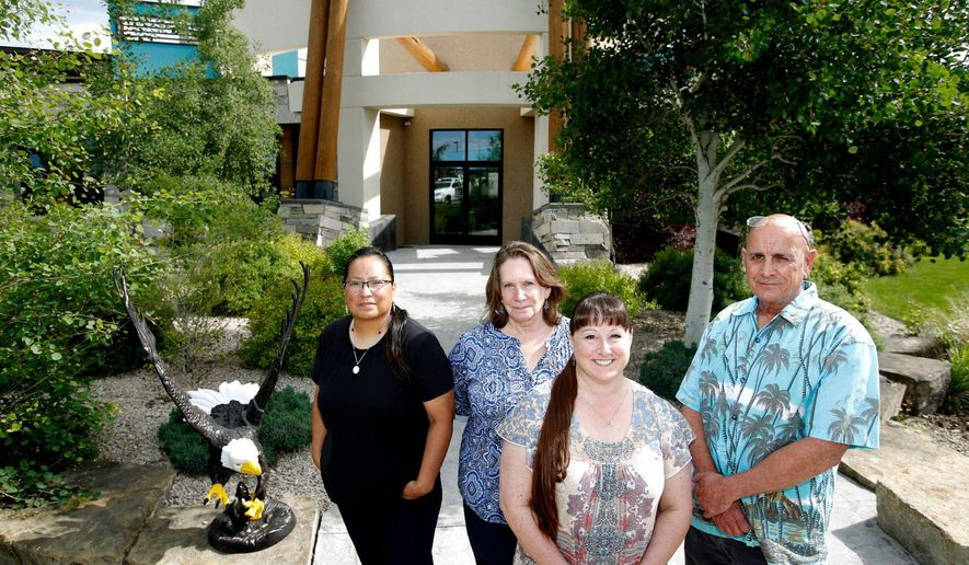 New Day Inc. staff, from left, Phillene Whiteman-Lacee, Liz Fuller, Cheryl Moats-DeCamp and Dana LeClair, pictured Tuesday, June 12, 2018 in front of the Eagles Nest Healing Center in Billings, Mont. (Casey Page/The Gazette via AP)