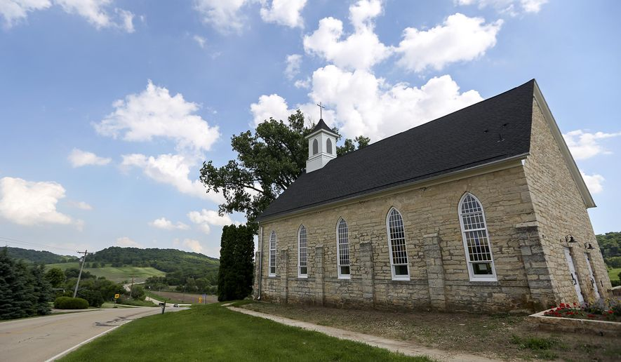 This Friday, June 1, 2018 photo shows the former Lattnerville Church in Graf, Iowa, which has been converted into an inn. (Nicki Kohl/Telegraph Herald via AP)