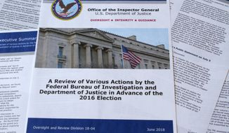 Part of the the Department of Justice Inspector General's report after its release in Washington, Thursday, June 14, 2018. (AP Photo/Jon Elswick)