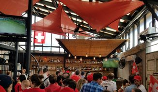 At Stable, a restaurant and bar in Washington, D.C., a crowd of Switzerland fans watch the Swiss men's national soccer team take on Brazil in the group stage of the 2018 World Cup on Sunday, June 17, 2018. (Adam Zielonka / The Washington Times)