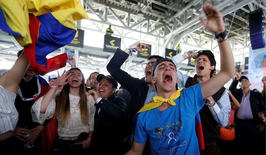 Supporters of Ivan Duque, candidate of the Democratic Centre party, celebrate the presidential election results in Bogota, Colombia, on Sunday. (Associated Press Photographs)