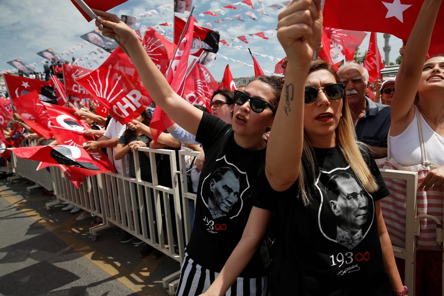 Wearing T-shirts with pictures of Turkish Republic founder Mustafa Kemal Ataturk, supporters rally for Muharrem Ince, who is seen as a strong contender to end President Recep Tayyip Erdogan's 16-year rule in presidential elections next week. (Associated Press)