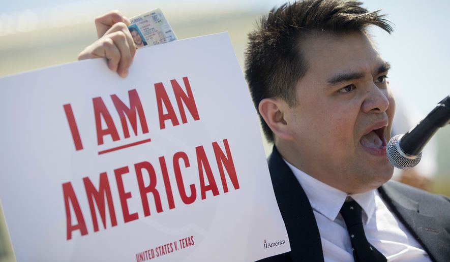 Jose Antonio Vargas, a journalist, filmmaker, and immigration rights activist, from San Francisco, holds up his California Driver's License as he speaks to supporters of fair immigration reform gather in front of the Supreme Court in Washington, Monday, April 18, 2016. The Supreme Court is taking up an important dispute over immigration that could affect millions of people who are living in the country illegally. The Obama administration is asking the justices in arguments today to allow it to put in place two programs that could shield roughly 4 million people from deportation and make them eligible to work in the United States. (AP Photo/Pablo Martinez Monsivais)