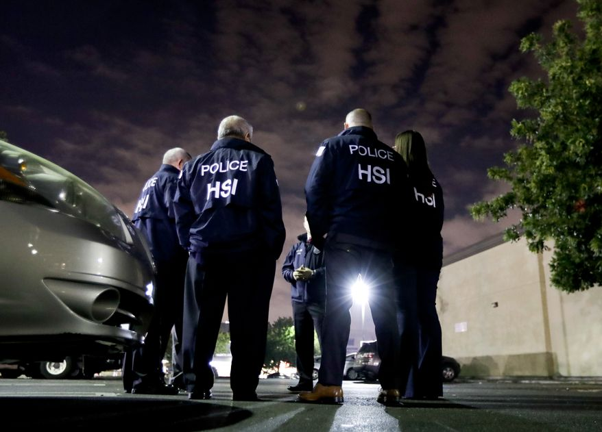 """FILE - In this Jan. 10, 2018, file photo U.S. Immigration and Customs Enforcement agents gather before serving a employment audit notice at a 7-Eleven convenience store in Los Angeles. Immigration officials have sharply increased audits of companies to verify that their employees are authorized to work in the country, signaling the Trump administration's crackdown on illegal immigration is reaching deeper into the workplace to create a """"culture of compliance"""" among employers who rely on immigrant labor. (AP Photo/Chris Carlson, File)"""