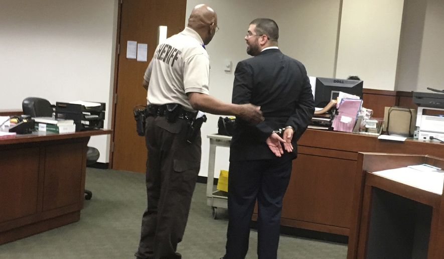 White nationalist Matthew Heimbach is led away in handcuffs on Tuesday, May 15, 2018 in Louisville, Kentucky, after a judge ruled that he violated the probation he was serving for physically harassing a protester at a 2016 Donald Trump campaign rally. Heimbach was arrested in March on battery charges after a domestic incident in Paoli, Indiana. (AP Photo/Dylan Lovan)