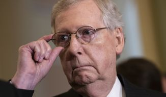 Senate Majority Leader Mitch McConnell, R-Ky., tells reporters he intends to cancel the traditional August recess and keep the Senate in session to deal with backlogged tasks, on Capitol Hill in Washington, Tuesday, June 5, 2018. (AP Photo/J. Scott Applewhite)