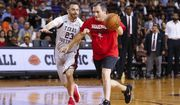 Senator Ted Cruz dribbles past Jimmy Kimmel during the Blobfish Basketball Classic and one-on-one interview at Texas Southern University's Health & Physical Education Arena Saturday, June 16, 2018 in Houston. Cruz challenged Kimmel to the game after Kimmel blamed the Houston Rockets playoff loss on the senator. Cruz won 11-9. (Michael Ciaglo/Houston Chronicle via AP)