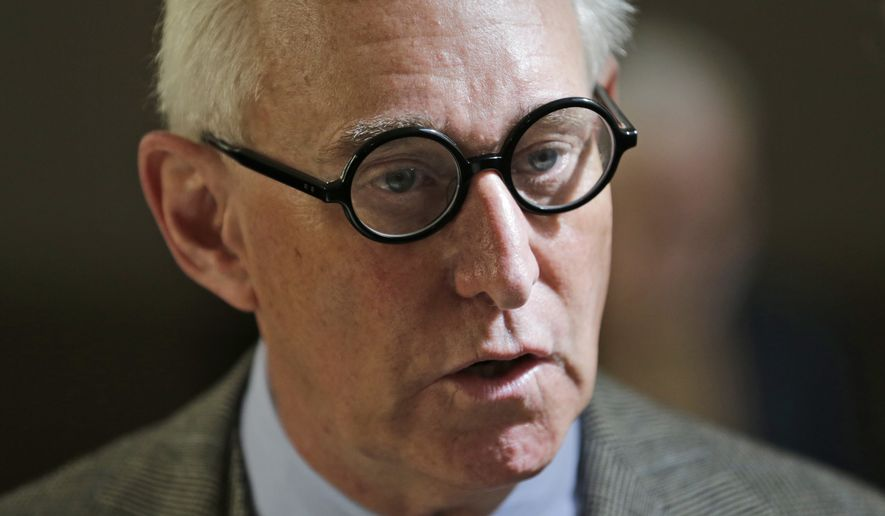Roger Stone talks to people outside a courtroom in New York, Thursday, March 30, 2017. (AP Photo/Seth Wenig) ** FILE **