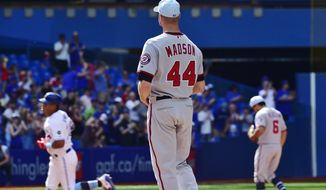 Washington Nationals relief pitcher Ryan Madson (44) watches as Toronto Blue Jays' Yangervis Solarte, left, rounds the bases after hitting a solo home run during eighth-inning baseball game action in Toronto, Sunday, June 17, 2018. (Frank Gunn/The Canadian Press via AP)
