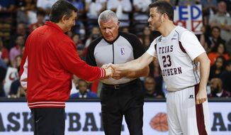 Sen. Ted Cruz and Jimmy Kimmel shake hands before the Blobfish Basketball Classic and one-on-one interview at Texas Southern University's Health & Physical Education Arena Saturday, June 16, 2018 in Houston. Cruz challenged Kimmel to the game after Kimmel blamed the Houston Rockets playoff loss on the senator. Cruz won 11-9. (Michael Ciaglo/Houston Chronicle via AP)
