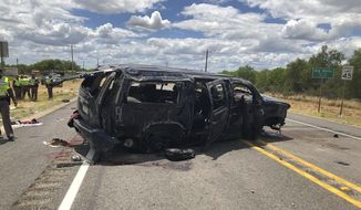 In this image tweeted by David Caltabiano of KABB/WOAI, a heavily damaged SUV is seen on Texas Highway 85 in Big Wells, Texas, after crashing while carrying more than a dozen people fleeing from Border Patrol agents, Sunday, June 17, 2018. (David Caltabiano/KABB/WOAI via AP)