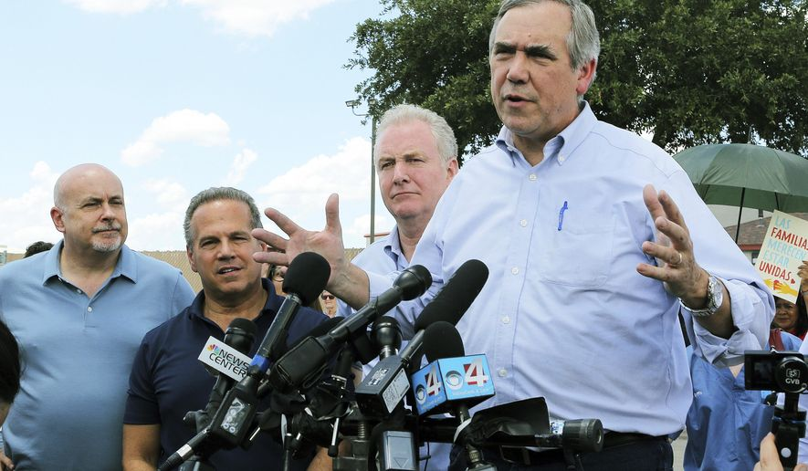 U.S. Sen. Jeff Merkley, from right, from Oregon, speaks to the media along with U.S. Sen. Chris Van Hollen, center, D-Md., U.S. Rep. David Cicilline, D-R.I., and U.S. Rep. Mark Pocan, D-Wis., in front of the U.S. Customs and Border Protection's Rio Grande Valley Sector's Centralized Processing Center in McAllen, Texas, Sunday, June 17, 2018. (Joel Martinez/The Monitor via AP)