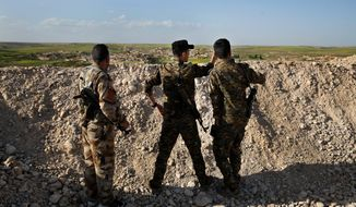 """As members of the U.S.-backed Syrian Manbij Military Council face Turkish-backed fighters, joint U.S.-Turkish military patrols have calmed tensions in the city for now. Defense Secretary James Mattis said, """"It is the most complex battle space I have seen."""" (Associated Press/File)"""