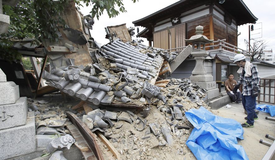 The gate of Myotoku-ji temple collapses after an earthquake hit Ibaraki City, Osaka, western Japan, Monday, June 18, 2018. A strong earthquake knocked over walls and set off scattered fires around metropolitan Osaka on Monday morning. (Yosuke Mizuno/Kyodo News via AP)