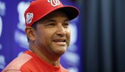 Washington Nationals manager Dave Martinez smiles during a media availability before the home opener baseball game against the New York Mets at Nationals Park, Thursday, April 5, 2018, in Washington. (AP Photo/Alex Brandon)