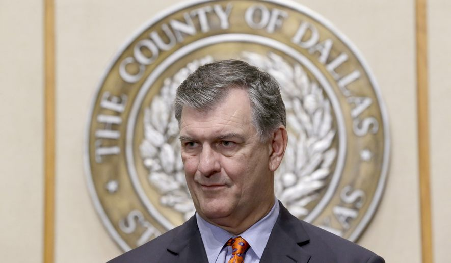 Dallas Mayor Mike Rawlings waits to speak at a news conference Wednesday, Oct. 15, 2014, in Dallas. The first contacts of the first Dallas Ebola infection are now cleared of the potential of developing the disease. (AP Photo/LM Otero)
