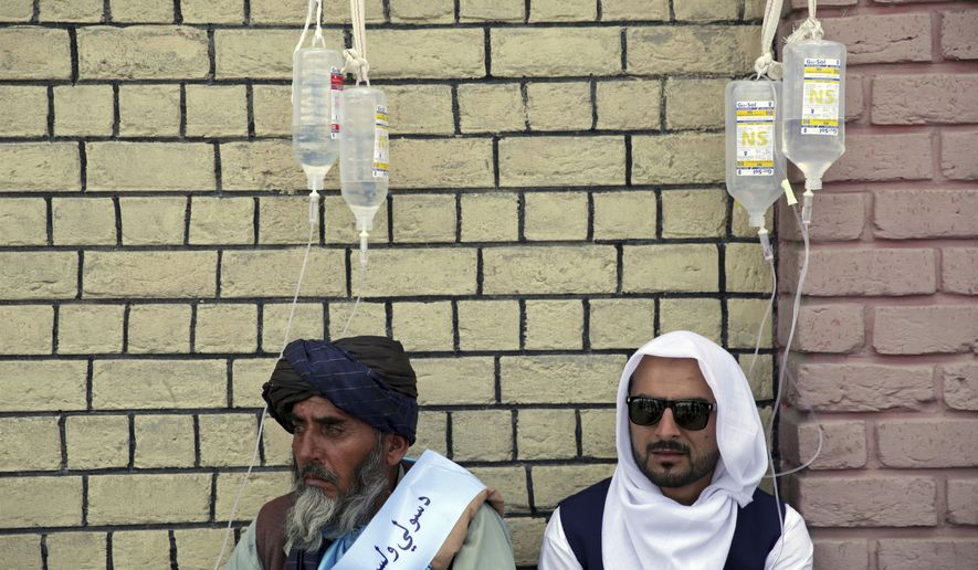 Members of the Helmand Peace Convoy, calling for an end to the 17-year war, are treated for dehydration in Kabul, Afghanistan, Monday, June 18, 2018 after trekking across the country on foot. The protest march began with a group of nine men and picked up supporters during the long journey, traveling more than 500 kilometers (300 miles) over nearly 40 days. The march began in the southern city of Lashkar Gah, in the Helmand province, an area largely under Taliban control. (AP Photo/Massoud Hossaini)