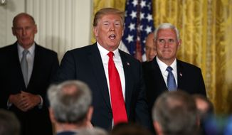 Vice President Mike Pence listens as President Donald Trump speaks during a meeting of the National Space Council in the East Room of the White House, Monday, June 18, 2018, in Washington. (AP Photo/Evan Vucci)