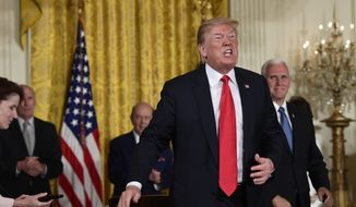 President Donald Trump speaks as he stands up after signing a space policy directive during a National Space Council meeting in the East Room of the White House in Washington, Monday, June 18, 2018. Vice President Mike Pence watches at right. (AP Photo/Susan Walsh)