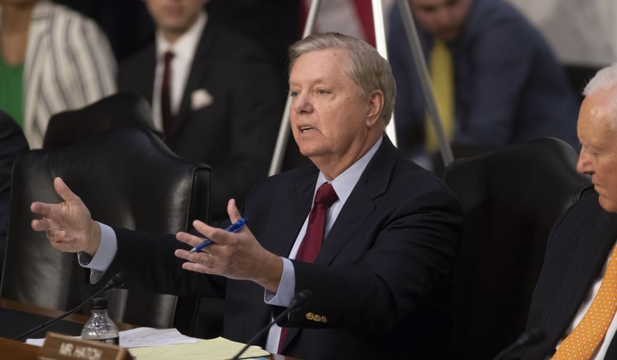 Sen. Lindsey Graham, R-S.C., questions Justice Department Inspector General Michael Horowitz and FBI Director Christopher Wray on the internal report of the FBI's Clinton email probe and the role of former FBI Director James Comey's actions during the 2016 presidential campaign, on Capitol Hill in Washington, Monday, June 18, 2018. (AP Photo/J. Scott Applewhite)