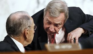 Senate Judiciary Committee Chairman Chuck Grassley, R-Iowa, left, speaks with Sen. Dick Durbin, D-Ill., during a hearing of the Senate Judiciary Committee to examine and Inspector General's report of the FBI's Clinton email probe, on Capitol Hill, Monday, June 18, 2018 in Washington. (AP Photo/Jacquelyn Martin)