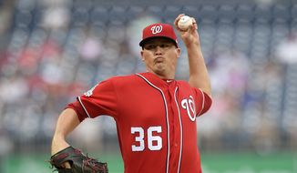 Washington Nationals relief pitcher Sammy Solis delivers a pitch during the sixth inning of the continuation of a suspended baseball game, Monday, June 18, 2018, in Washington. (AP Photo/Nick Wass) **FILE**